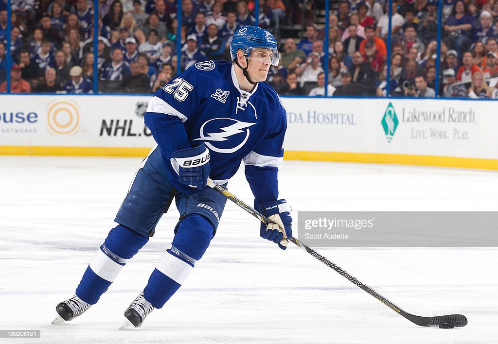 <a gi-track='captionPersonalityLinkClicked' href=/galleries/search?phrase=Matt+Carle&family=editorial&specificpeople=582495 ng-click='$event.stopPropagation()'>Matt Carle</a> #25 of the Tampa Bay Lightning controls the puck during the second period of an NHL game against the Philadelphia Flyers at the Tampa Bay Times Forum on January 27, 2013 in Tampa, Florida.