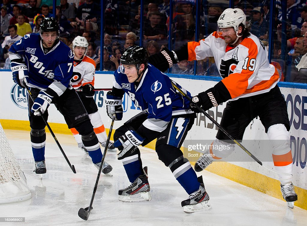 <a gi-track='captionPersonalityLinkClicked' href=/galleries/search?phrase=Matt+Carle&family=editorial&specificpeople=582495 ng-click='$event.stopPropagation()'>Matt Carle</a> #25 of the Tampa Bay Lightning controls the puck in front of <a gi-track='captionPersonalityLinkClicked' href=/galleries/search?phrase=Scott+Hartnell&family=editorial&specificpeople=201889 ng-click='$event.stopPropagation()'>Scott Hartnell</a> #19 of the Philadelphia Flyers during the second period of the game at the Tampa Bay Times Forum on March 18, 2013 in Tampa, Florida.