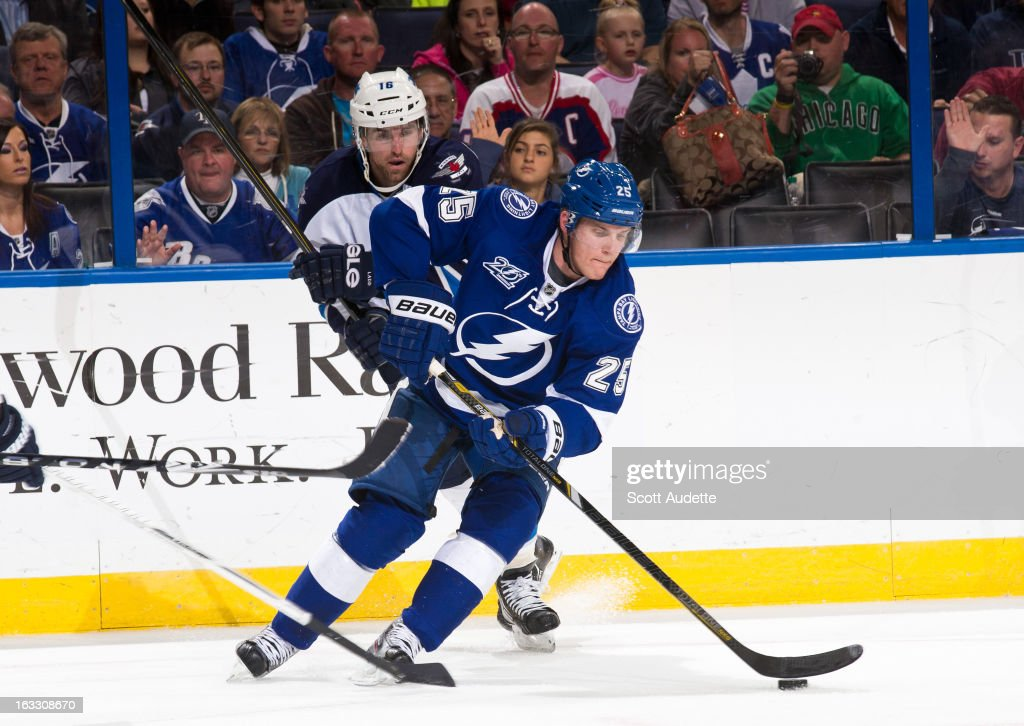 <a gi-track='captionPersonalityLinkClicked' href=/galleries/search?phrase=Matt+Carle&family=editorial&specificpeople=582495 ng-click='$event.stopPropagation()'>Matt Carle</a> #25 of the Tampa Bay Lightning moves the puck down ice during the second period of the game against the Winnipeg Jets at the Tampa Bay Times Forum on March 7, 2013 in Tampa, Florida.