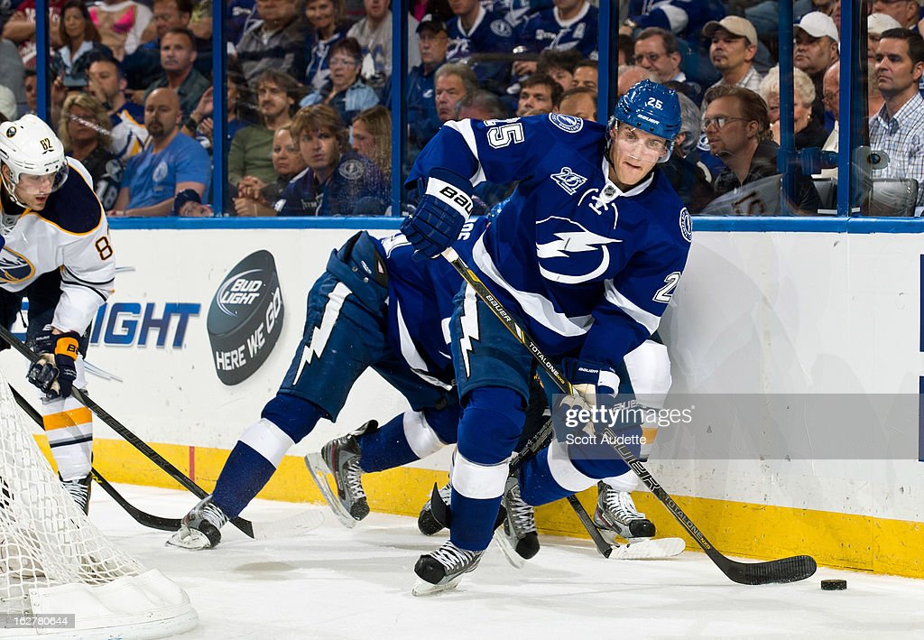 <a gi-track='captionPersonalityLinkClicked' href=/galleries/search?phrase=Matt+Carle&family=editorial&specificpeople=582495 ng-click='$event.stopPropagation()'>Matt Carle</a> #25 of the Tampa Bay Lightning moves the puck during the second period of the game against the Buffalo Sabres at the Tampa Bay Times Forum on February 26, 2013 in Tampa, Florida.