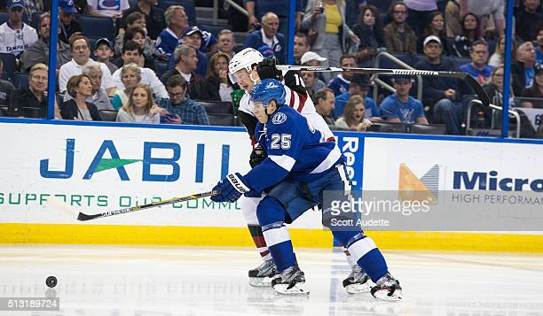 Matt Carle of the Tampa Bay Lightning skates against Shane Doan of the Arizona Coyotes during the second period at the Amalie Arena on February 23...