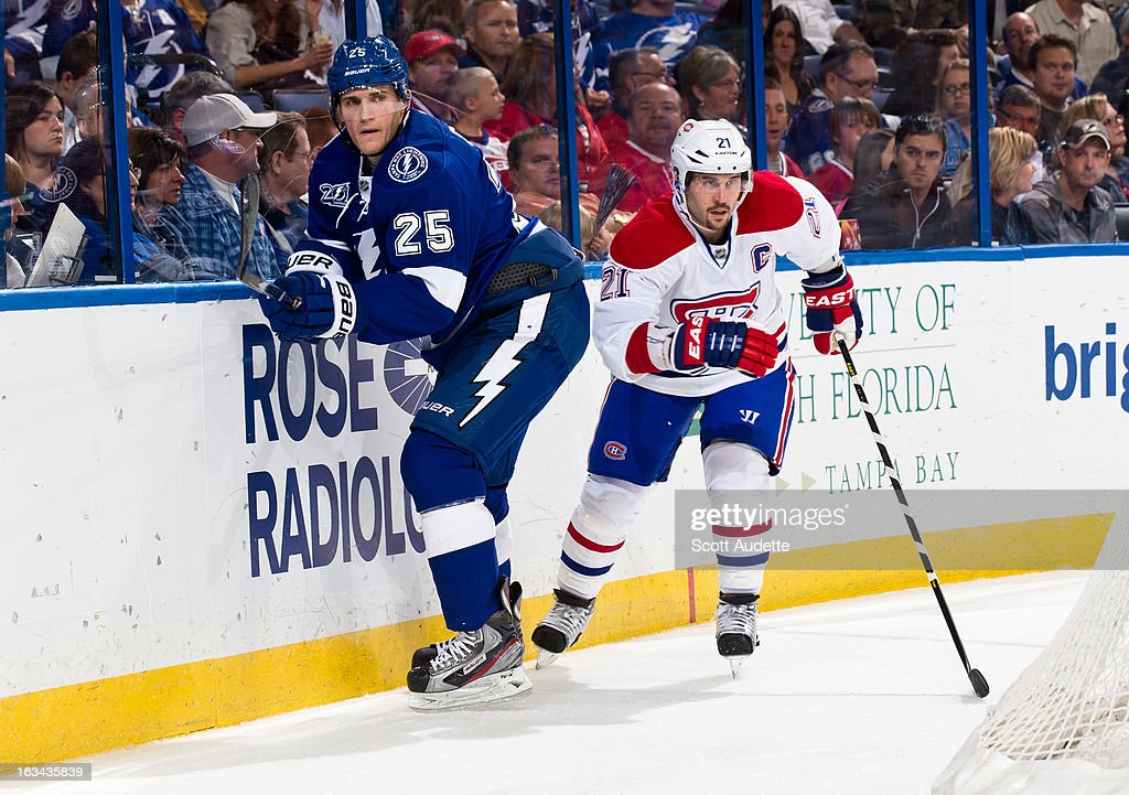 <a gi-track='captionPersonalityLinkClicked' href=/galleries/search?phrase=Matt+Carle&family=editorial&specificpeople=582495 ng-click='$event.stopPropagation()'>Matt Carle</a> #25 of the Tampa Bay Lightning skates in front of <a gi-track='captionPersonalityLinkClicked' href=/galleries/search?phrase=Brian+Gionta&family=editorial&specificpeople=202116 ng-click='$event.stopPropagation()'>Brian Gionta</a> #21 of the Montreal Canadiens during the second period of the game at the Tampa Bay Times Forum on March 9, 2013 in Tampa, Florida.