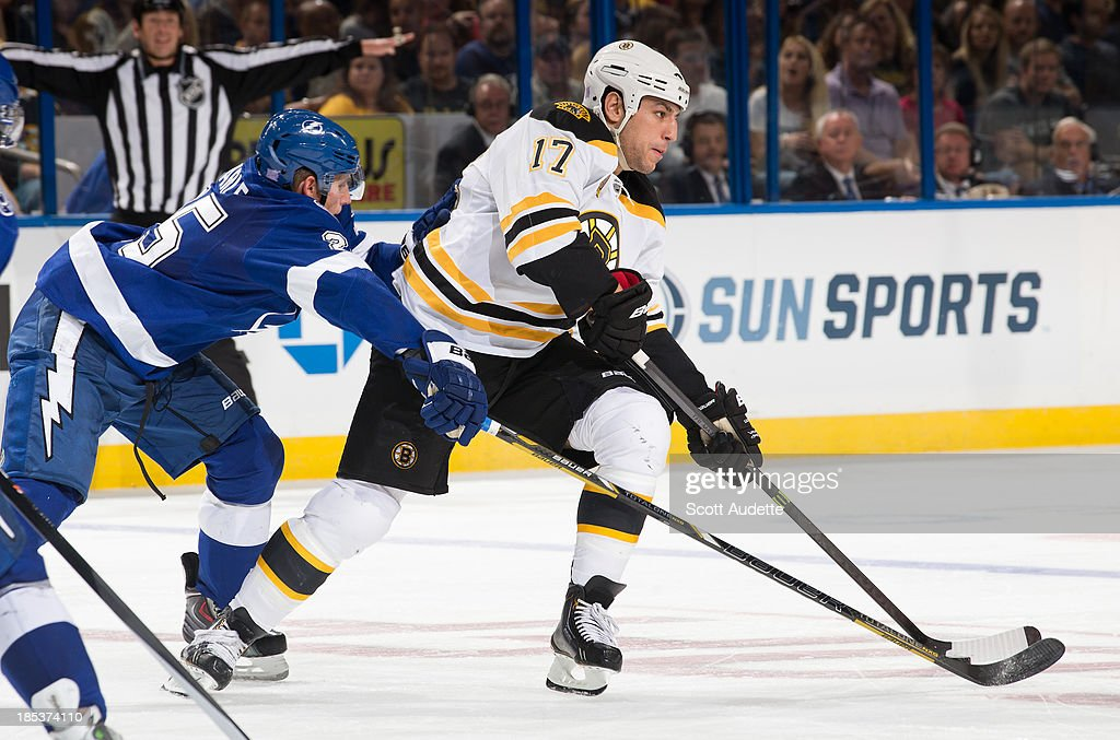 <a gi-track='captionPersonalityLinkClicked' href=/galleries/search?phrase=Matt+Carle&family=editorial&specificpeople=582495 ng-click='$event.stopPropagation()'>Matt Carle</a> #25 of the Tampa Bay Lightning tries to poke the puck away from <a gi-track='captionPersonalityLinkClicked' href=/galleries/search?phrase=Milan+Lucic&family=editorial&specificpeople=537957 ng-click='$event.stopPropagation()'>Milan Lucic</a> #17 of the Boston Bruins during the second period at the Tampa Bay Times Forum on October 19, 2013 in Tampa, Florida.