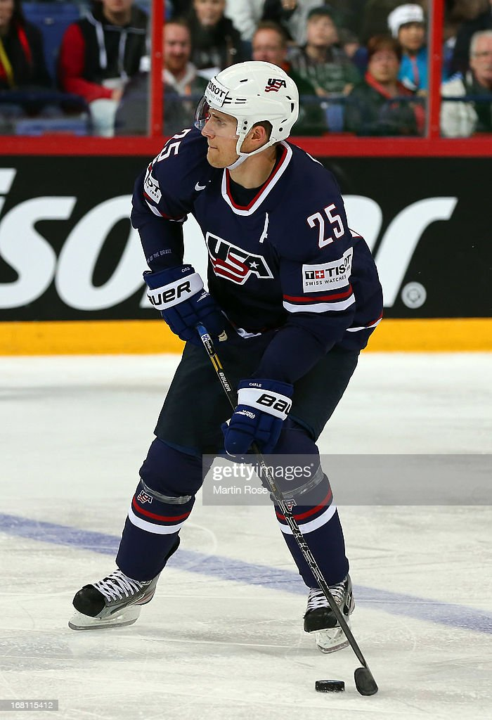 <a gi-track='captionPersonalityLinkClicked' href=/galleries/search?phrase=Matt+Carle&family=editorial&specificpeople=582495 ng-click='$event.stopPropagation()'>Matt Carle</a> of USA skates wit the puck during the IIHF World Championship group H match between Latvia and USA at Hartwall Areena on May 5, 2013 in Helsinki, Finland.