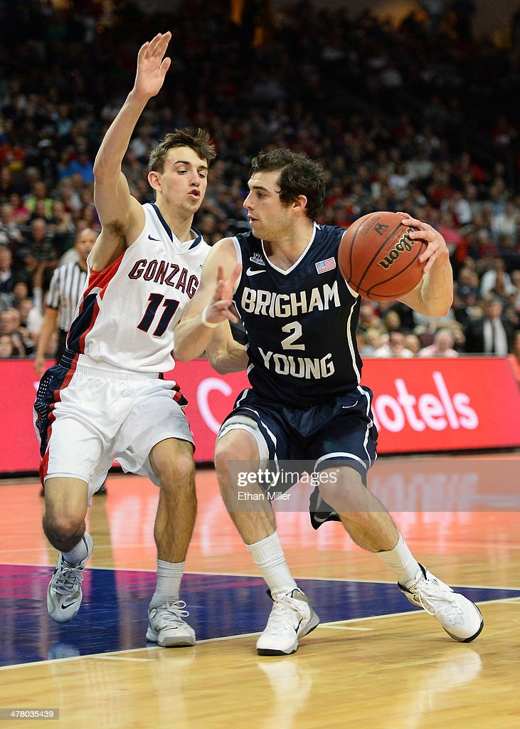 Matt Carlino #2 of the Brigham Young Cougars drives against David Stockton #11 of the Gonzaga Bulldogs during the championship game of the West Coast Conference Basketball tournament at the Orleans Arena on March 11, 2014 in Las Vegas, Nevada. Gonzaga won 75-64.