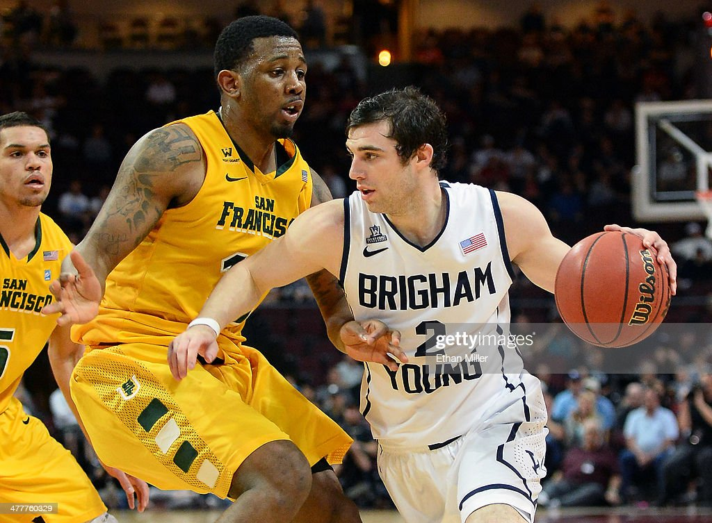 Matt Carlino #2 of the Brigham Young Cougars drives against Kruize Pinkins #15 of the San Francisco Dons during a semifinal game of the West Coast Conference Basketball tournament at the Orleans Arena on March 10, 2014 in Las Vegas, Nevada. Brigham Young won 79-77 in overtime.