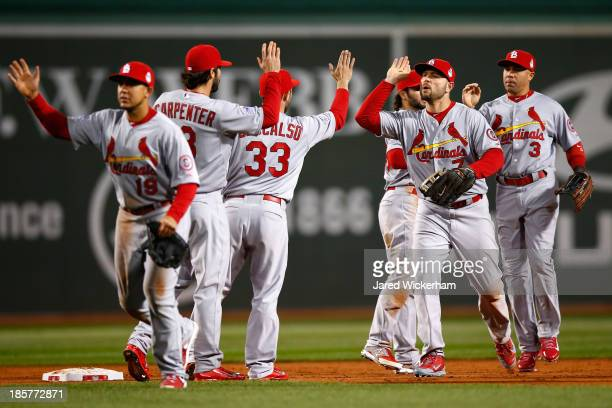 Matt Carpenter and Matt Holliday of the St Louis Cardinals celebrate after defeating the Boston Red Sox 42 in Game Two of the 2013 World Series at...