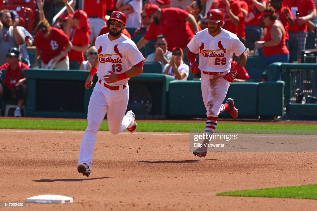 Matt Carpenter #13 and Tommy Pham #28 of the St. Louis Cardinals rounds the bases after Pham hit a two-run home run against the Cincinnati Reds in the fifth inning at Busch Stadium on September 14, 2017 in St. Louis, Missouri.