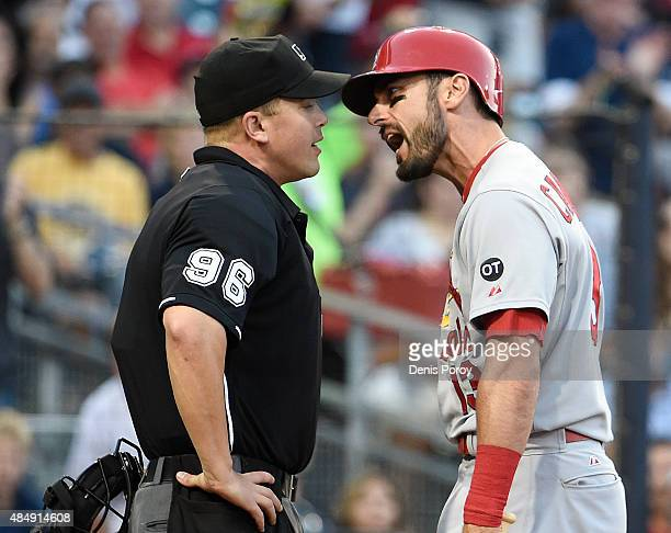 Matt Carpenter of the St Louis Cardinals argues with home plate umpire Chris Segal after being ejected from the game during the fifth inning of a...