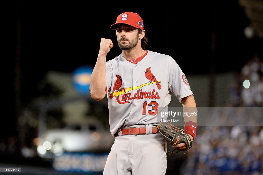 Matt Carpenter #13 of the St. Louis Cardinals celebrates after turning a double play in the ninth inning against the Los Angeles Dodgers in Game Four of the National League Championship Series at Dodger Stadium on October 15, 2013 in Los Angeles, California.