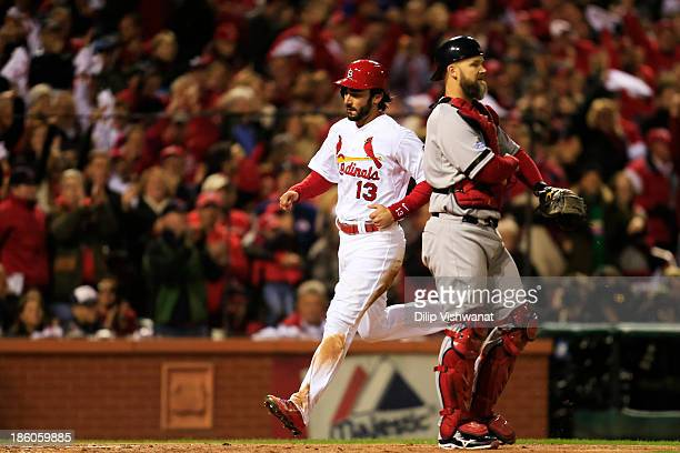 Matt Carpenter of the St Louis Cardinals crosses home plate after scoring a run off of Carlos Beltran singled to center field in the third inning...