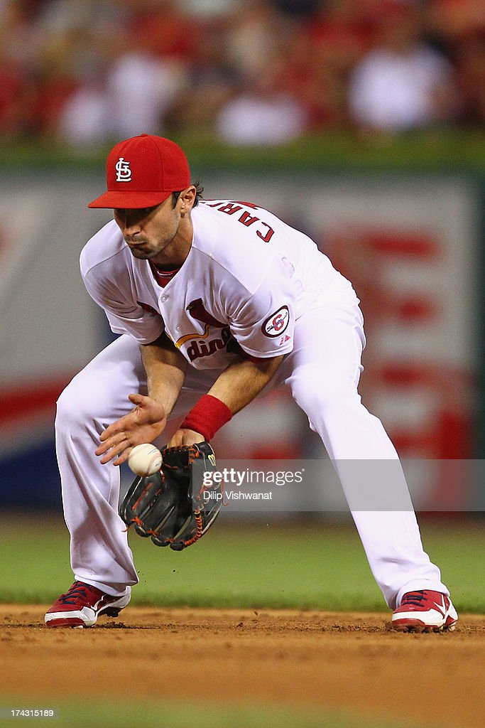 Matt Carpenter #13 of the St. Louis Cardinals fields a ground ball against the Philadelphia Phillies in the eighth inning at Busch Stadium on July 23, 2013 in St. Louis, Missouri. The Cardinals beat the Phillies 4-1.