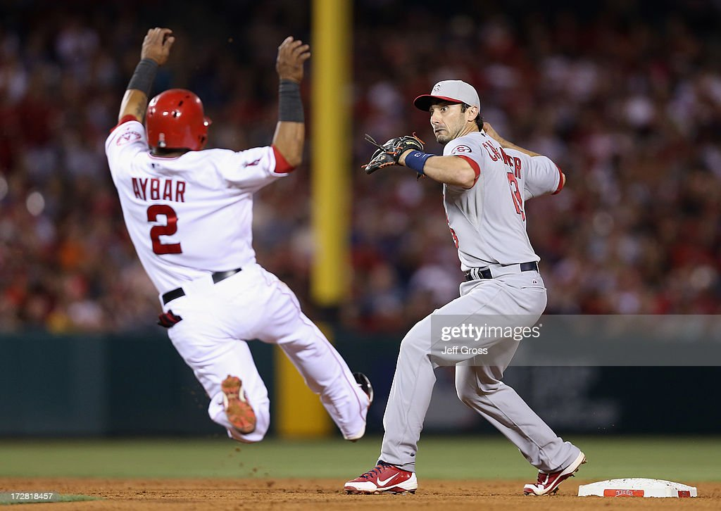 Matt Carpenter #13 of the St. Louis Cardinals forces <a gi-track='captionPersonalityLinkClicked' href=/galleries/search?phrase=Erick+Aybar&family=editorial&specificpeople=551376 ng-click='$event.stopPropagation()'>Erick Aybar</a> #2 of the Los Angeles Angels of Anaheim out at second before throwing to first to complete the double play in the eighth inning at Angel Stadium of Anaheim on July 4, 2013 in Anaheim, California.