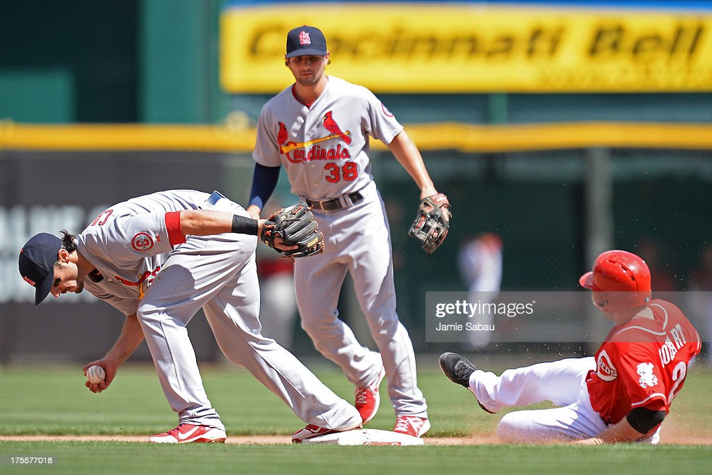 Matt Carpenter #13 of the St. Louis Cardinals forces out <a gi-track='captionPersonalityLinkClicked' href=/galleries/search?phrase=Zack+Cozart&family=editorial&specificpeople=6889199 ng-click='$event.stopPropagation()'>Zack Cozart</a> #2 of the Cincinnati Reds at second base in the eighth inning after bobbling the ground ball at Great American Ball Park on August 4, 2013 in Cincinnati, Ohio. St. Louis defeated Cincinnati 15-2.