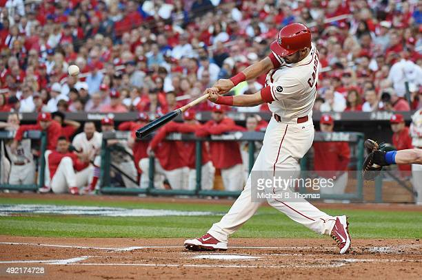 Matt Carpenter of the St Louis Cardinals hits a solo home run in the first inning against the Chicago Cubs during game two of the National League...