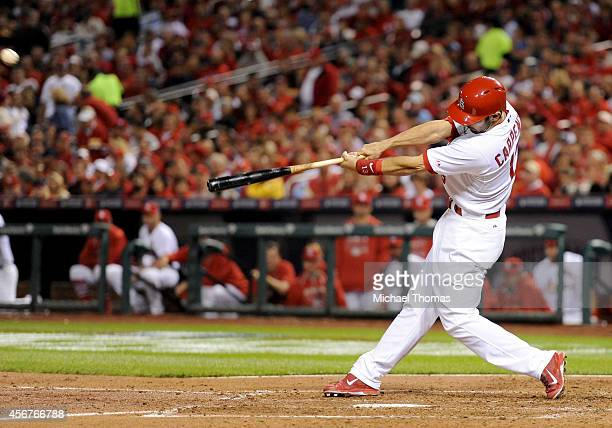 Matt Carpenter of the St Louis Cardinals hits a third inning solo home run against the Los Angeles Dodgers in Game Three of the National League...