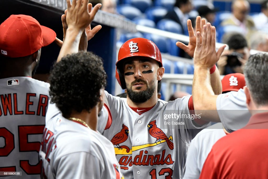 Matt Carpenter #13 of the St. Louis Cardinals is congratulated by teammates after scoring in the third inning against the Miami Marlinsat Marlins Park on May 10, 2017 in Miami, Florida.