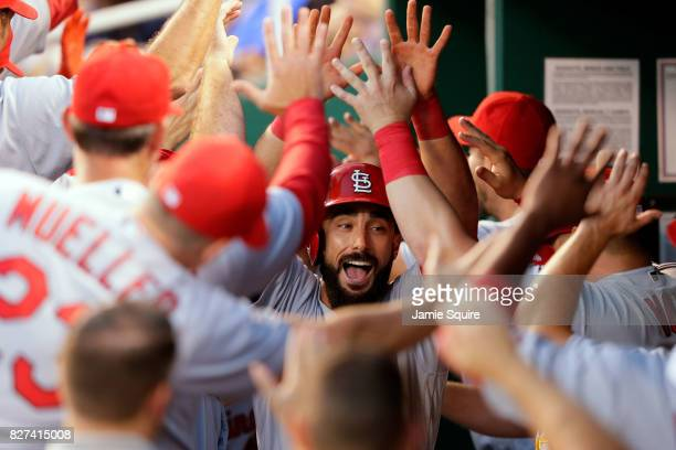 Matt Carpenter of the St Louis Cardinals is congratulated by teammates in the dugout after hitting a threerun home run during the 4th inning of the...