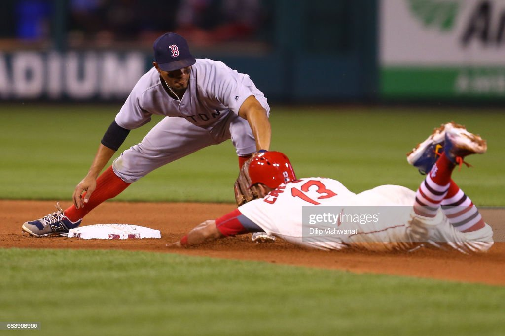 Matt Carpenter #13 of the St. Louis Cardinals is tagged out at second base by Xander Bogaerts #2 of the Boston Red Sox in the fifth inning at Busch Stadium on May 16, 2017 in St. Louis, Missouri.