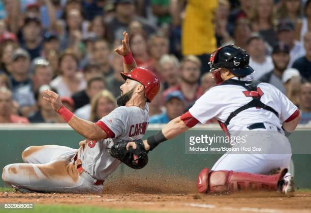 Matt Carpenter of the St Louis Cardinals is tagged out by Christian Vazquez of the Boston Red Sox in the second inning on August 16 2017 at Fenway...
