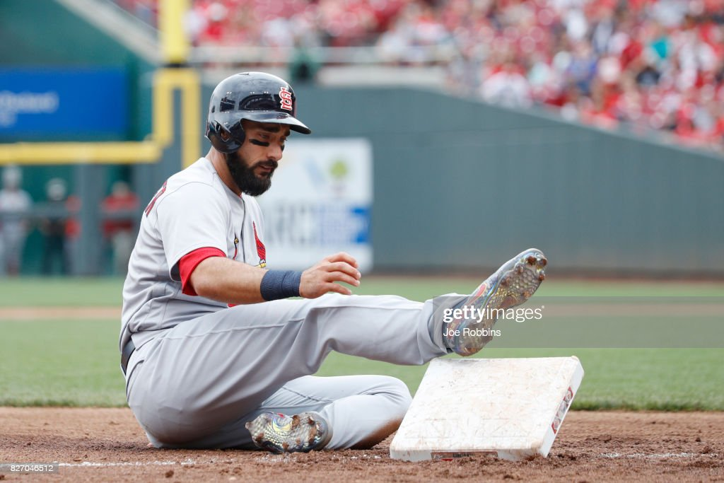 Matt Carpenter #13 of the St. Louis Cardinals keeps his foot on third base after it came out of the ground after a two-run triple and slide in the fourth inning of a game against the Cincinnati Reds at Great American Ball Park on August 6, 2017 in Cincinnati, Ohio. The Cardinals defeated the Reds 13-4.