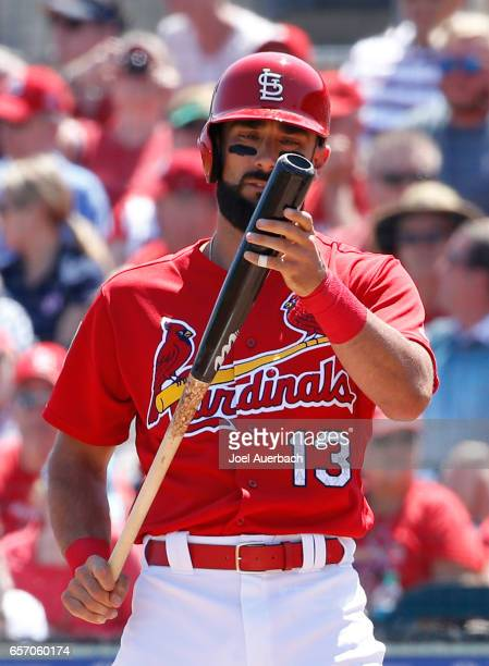 Matt Carpenter of the St Louis Cardinals looks at his bat prior to batting against the Washington Nationals during a spring training game at Roger...