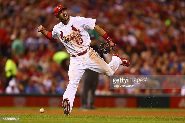 Matt Carpenter of the St Louis Cardinals misplays a ground ball in the seventh inning against the Milwaukee Brewers at Busch Stadium on September 18...