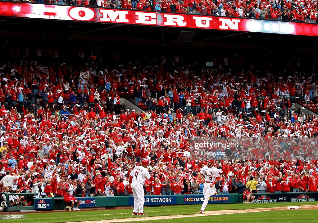 Matt Carpenter #13 of the St. Louis Cardinals rounds the bases after he hits a two-run home run in the third inning against the San Francisco Giants in Game Three of the National League Championship Series at Busch Stadium on October 17, 2012 in St Louis, Missouri.