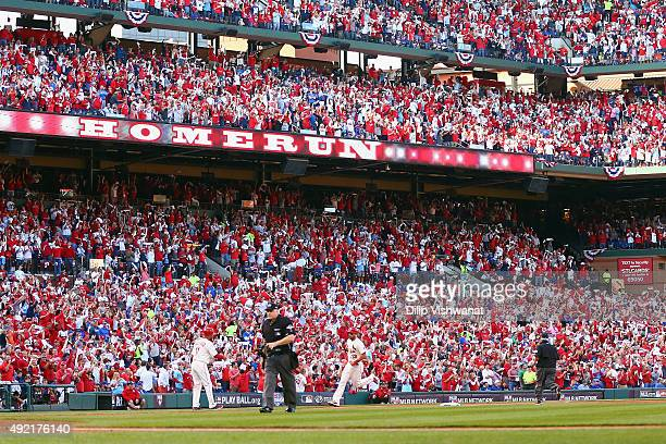 Matt Carpenter of the St Louis Cardinals runs the bases after hitting a solo home run in the first inning against the Chicago Cubs during game two of...