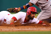 Matt Carpenter of the St Louis Cardinals safely dives back to first base against the Houston Astros in the sixth inning at Busch Stadium on June 15...