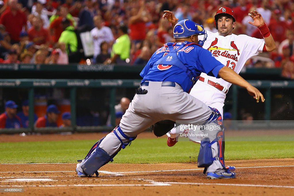 Matt Carpenter #13 of the St. Louis Cardinals scores a run against <a gi-track='captionPersonalityLinkClicked' href=/galleries/search?phrase=Welington+Castillo&family=editorial&specificpeople=4959193 ng-click='$event.stopPropagation()'>Welington Castillo</a> #5 of the Chicago Cubs in the first inning at Busch Stadium on August 29, 2014 in St. Louis, Missouri.