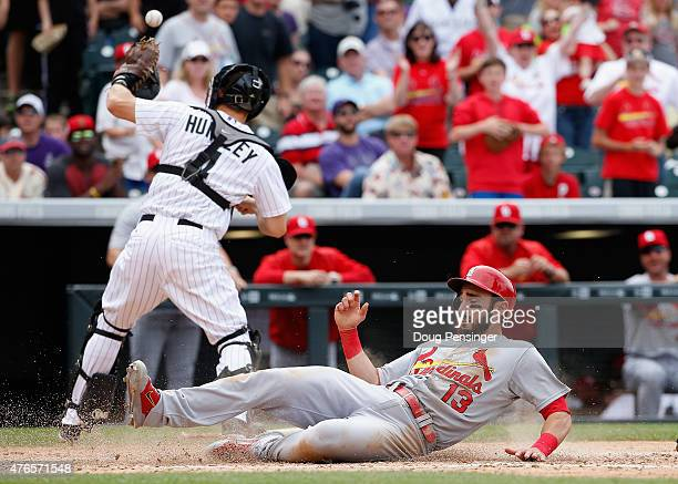 Matt Carpenter of the St Louis Cardinals scores on a double by Mark Reynolds of the St Louis Cardinals as catcher Nick Hundley of the Colorado...