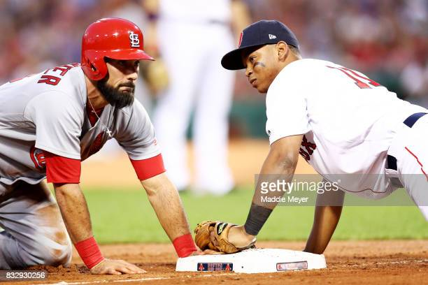 Matt Carpenter of the St Louis Cardinals slides safely into third past Rafael Devers of the Boston Red Sox during the second inning at Fenway Park on...