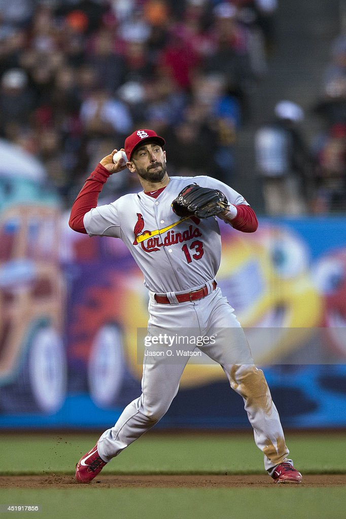 Matt Carpenter of the St Louis Cardinals throws to first base after fielding a ground ball hit off the bat of Pablo Sandoval of the San Francisco...
