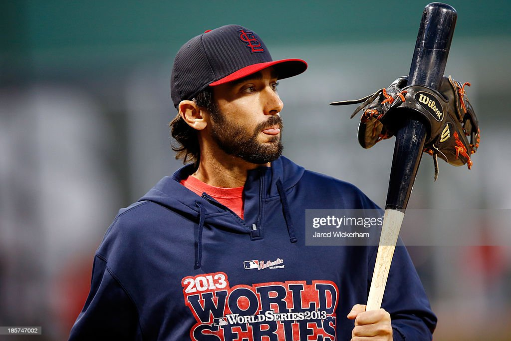 Matt Carpenter #13 of the St. Louis Cardinals with his bat and his glove before Game Two of the 2013 World Series against the Boston Red Sox at Fenway Park on October 24, 2013 in Boston, Massachusetts.