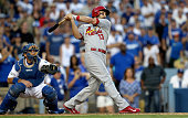 Matt Carpenter outfield the St Louis Cardinals hits a threerun double in the seventh inning against the Los Angeles Dodgers during Game One of the...