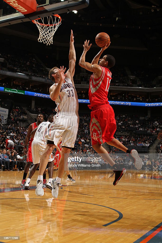 Matt Carroll #33 of the Charlotte Bobcats blocks a shot against Kevin Martin #12 of the Houston Rockets during the game at the Time Warner Cable Arena on January 10, 2012 in Charlotte, North Carolina.