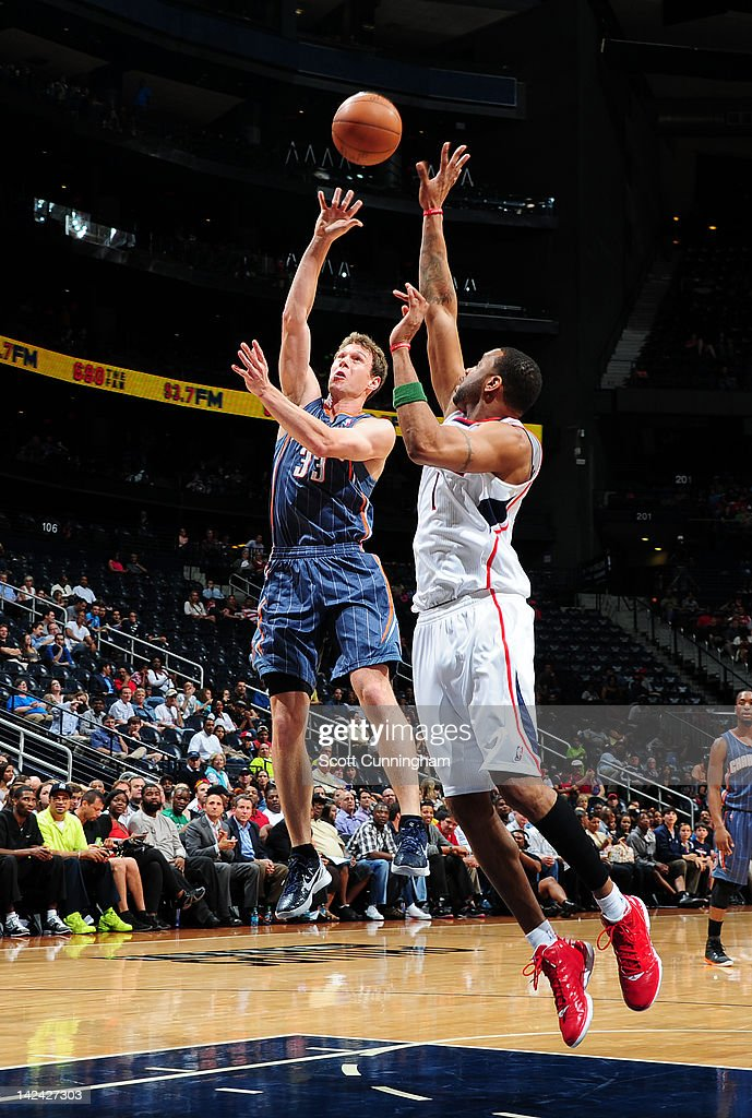 <a gi-track='captionPersonalityLinkClicked' href=/galleries/search?phrase=Matt+Carroll+-+Basketball+Player&family=editorial&specificpeople=213200 ng-click='$event.stopPropagation()'>Matt Carroll</a> #33 of the Charlotte Bobcats shoots against <a gi-track='captionPersonalityLinkClicked' href=/galleries/search?phrase=Tracy+McGrady&family=editorial&specificpeople=201486 ng-click='$event.stopPropagation()'>Tracy McGrady</a> #1 of the Atlanta Hawks on April 4, 2012 at Philips Arena in Atlanta, Georgia.