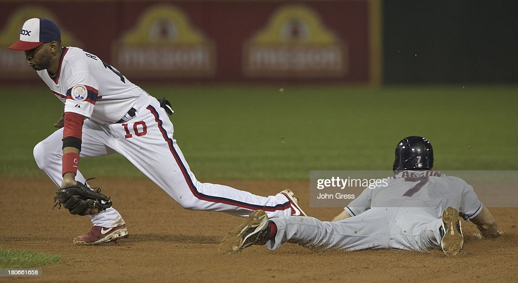 Matt Carson #7 of the Cleveland Indians seals second base as <a gi-track='captionPersonalityLinkClicked' href=/galleries/search?phrase=Alexei+Ramirez&family=editorial&specificpeople=690568 ng-click='$event.stopPropagation()'>Alexei Ramirez</a> #10 of the Chicago White Sox catches the ball during in the eighth inning of their MLB game at U.S. Cellular Field on September 15, 2013 in Chicago, Illinois.