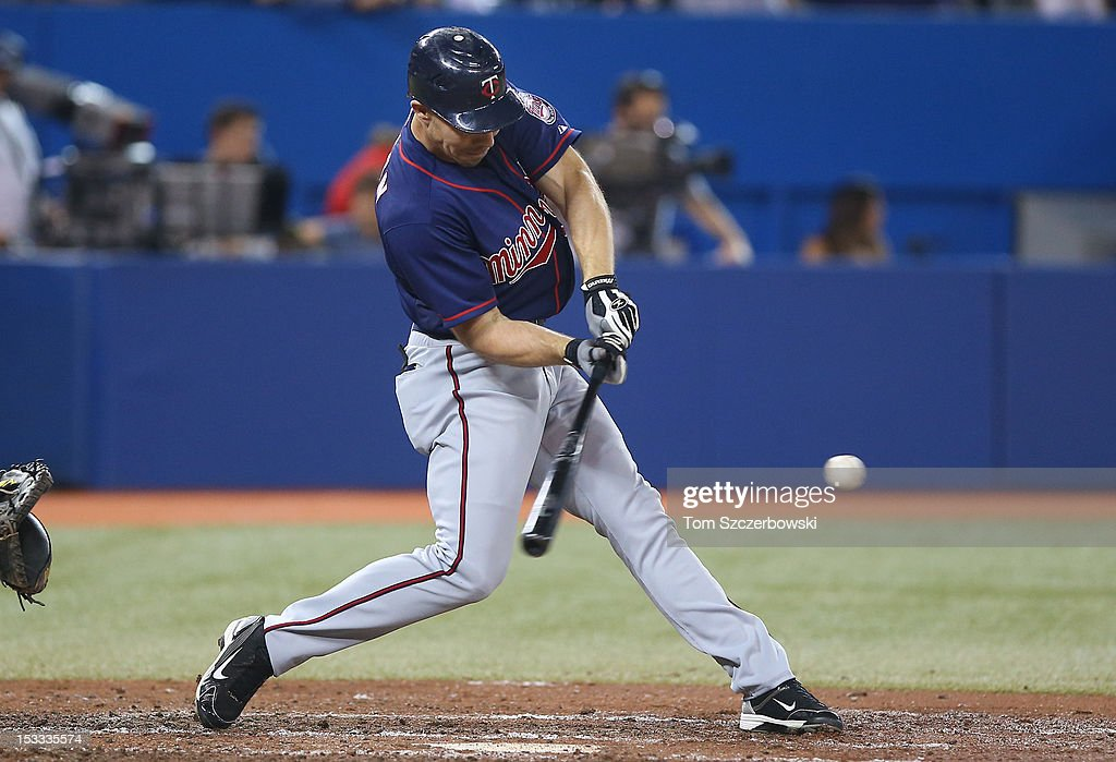 Matt Carson #22 of the Minnesota Twins hits an RBI groundout in the fourth inning during MLB game action against the Toronto Blue Jays on October 3, 2012 at Rogers Centre in Toronto, Ontario, Canada.