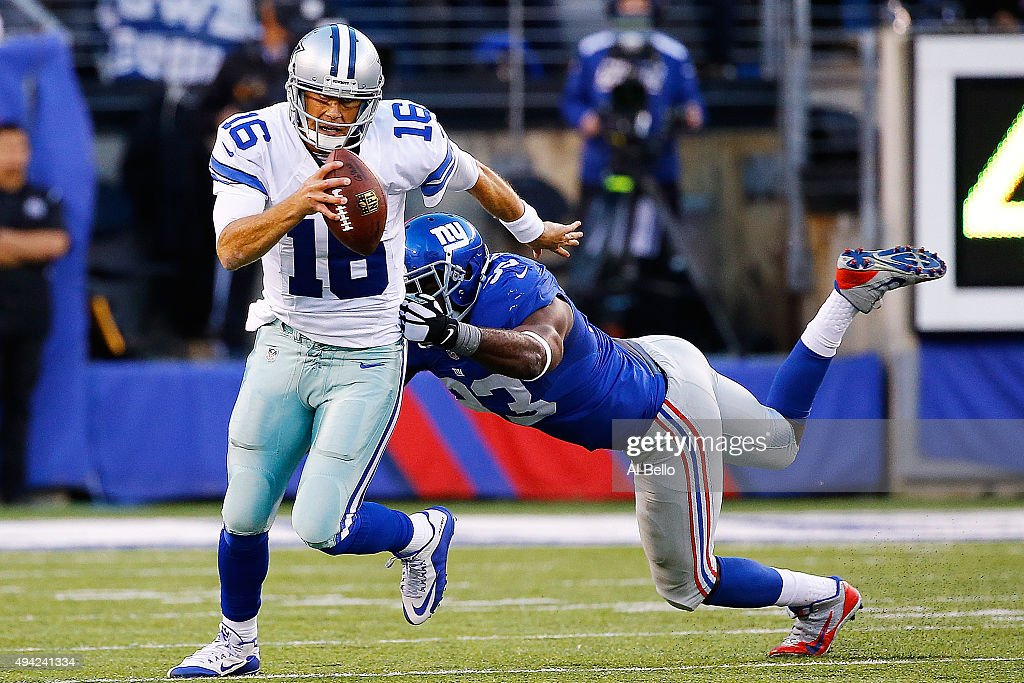 <a gi-track='captionPersonalityLinkClicked' href=/galleries/search?phrase=Matt+Cassel&family=editorial&specificpeople=567575 ng-click='$event.stopPropagation()'>Matt Cassel</a> #16 of the Dallas Cowboys escapes the tackle attempt by <a gi-track='captionPersonalityLinkClicked' href=/galleries/search?phrase=George+Selvie&family=editorial&specificpeople=4483733 ng-click='$event.stopPropagation()'>George Selvie</a> #93 of the New York Giants during the second quarter at MetLife Stadium on October 25, 2015 in East Rutherford, New Jersey.