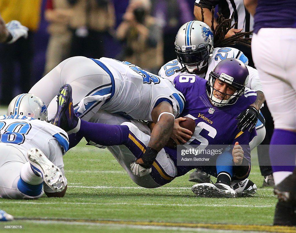 <a gi-track='captionPersonalityLinkClicked' href=/galleries/search?phrase=Matt+Cassel&family=editorial&specificpeople=567575 ng-click='$event.stopPropagation()'>Matt Cassel</a> #16 of the Minnesota Vikings gets sacked by <a gi-track='captionPersonalityLinkClicked' href=/galleries/search?phrase=Ashlee+Palmer&family=editorial&specificpeople=4511195 ng-click='$event.stopPropagation()'>Ashlee Palmer</a> #58 and <a gi-track='captionPersonalityLinkClicked' href=/galleries/search?phrase=Louis+Delmas&family=editorial&specificpeople=5680392 ng-click='$event.stopPropagation()'>Louis Delmas</a> #26 of the Detroit Lions on December 29, 2013 at Mall of America Field at the Hubert H. Humphrey Metrodome in Minneapolis, Minnesota.