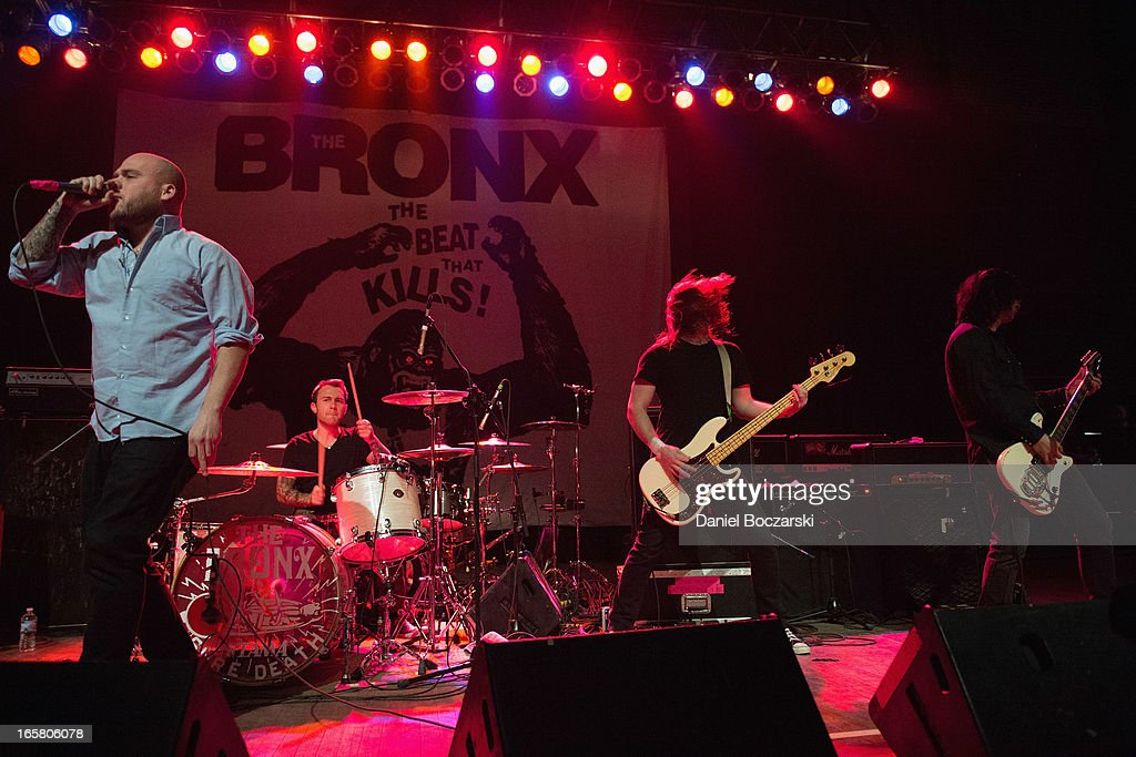Matt Caughthran, Jorma Vik and Brad Magers of The Bronx during their performance on stage as a supporting act for Bad Religion at Congress Theater on April 5, 2013 in Chicago, Illinois.