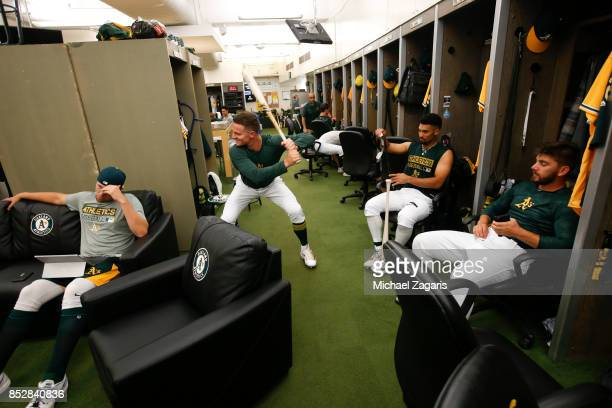 Matt Chapman Blake Treinen Marcus Semien and Sam Moll of the Oakland Athletics relax in the clubhouse prior toduring the game against the Los Angeles...