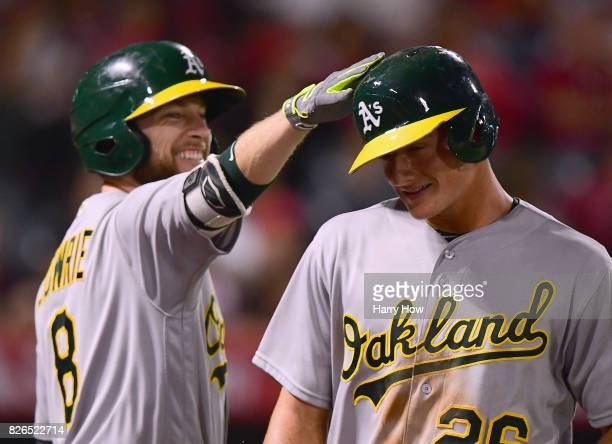 Matt Chapman of the Oakland Athletics celebrates his run with Jed Lowrie to take a 62 lead over the Los Angeles Angels during the sixth inning at...