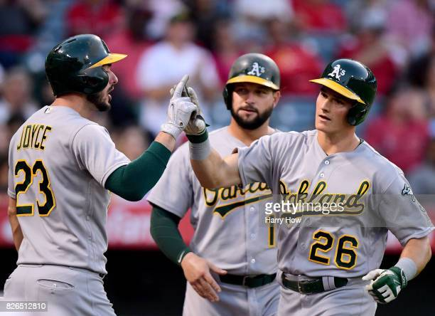 Matt Chapman of the Oakland Athletics celebrates his three run homerun with Matt Joyce and Yonder Alonso to take a 30 lead over the Los Angeles...