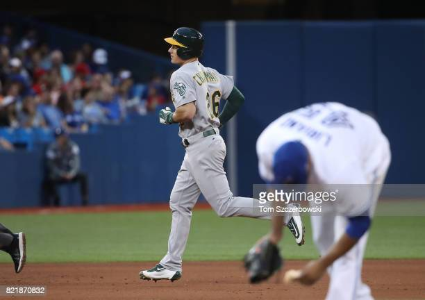 Matt Chapman of the Oakland Athletics circles the bases after hitting a solo home run in the fifth inning during MLB game action as Francisco Liriano...