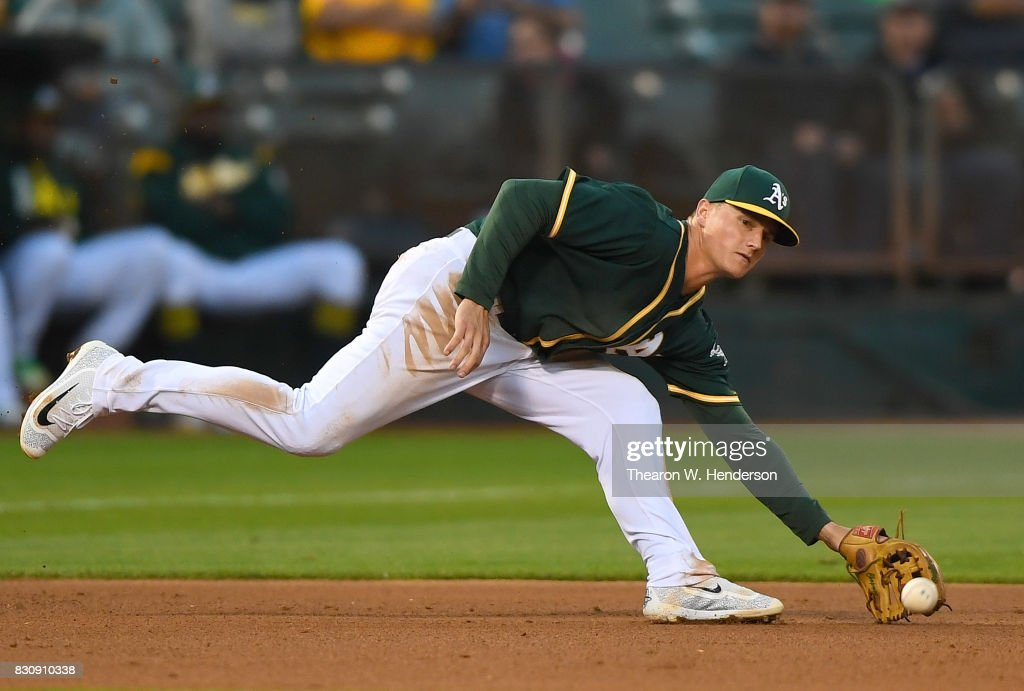 Matt Chapman #26 of the Oakland Athletics reacts to his left to watch the ball get past his reach for a base hit off the bat of Joey Rickard #23 of the Baltimore Orioles in the top of the six inning at Oakland Alameda Coliseum on August 12, 2017 in Oakland, California. The Orioles won the game 12-5.
