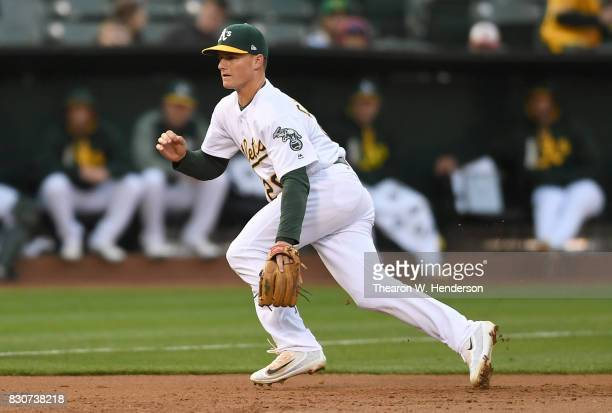 Matt Chapman of the Oakland Athletics reacts to his right for a ground ball that gets past him for a double off the bat of Trey Mancini of the...