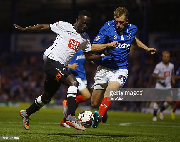 Matt Clarke of Portsmouth tries to tackle Simon Dawkins of Derby County during the Capital One Cup First Round match between Portsmouth v Derby...